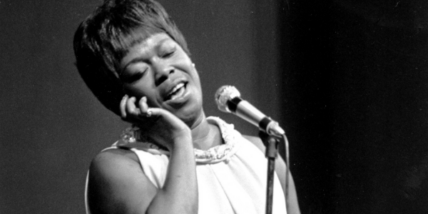 Sarah Vaughan sings into a microphone