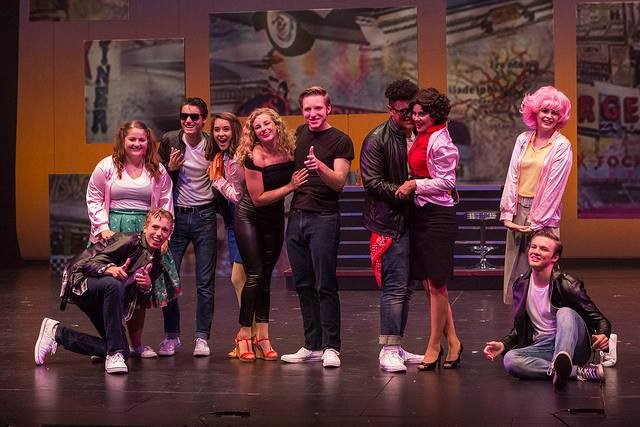 "The cast of Civic Theatre's ""Grease"" on stage"