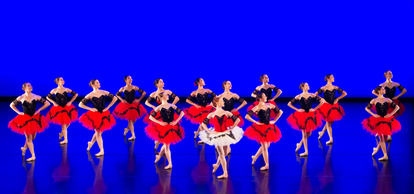 A troupe of dancers on stage
