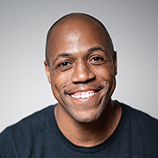 Comedian Dwight Simmons smiles for a portrait