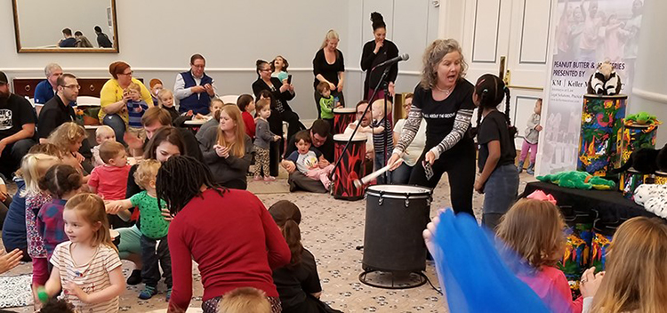 Children enjoy a drum activity at the Palladium